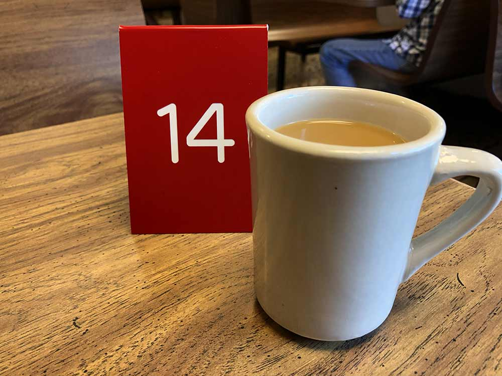 Coffee and an order number at my table at Pearly's Famous Country Cooking.