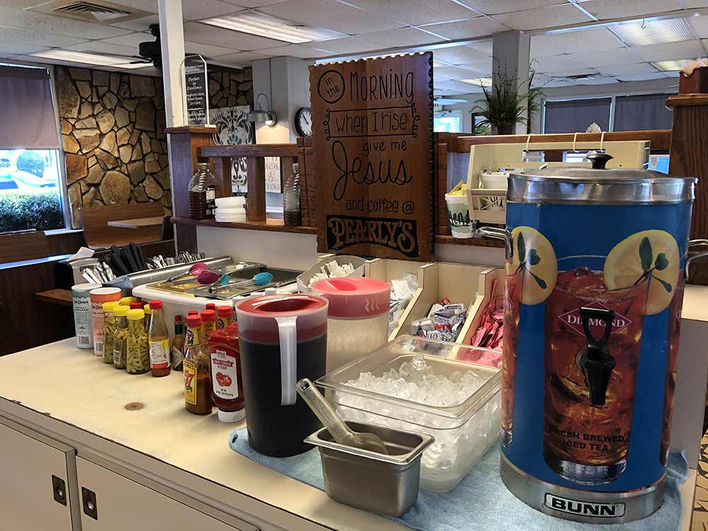 Plenty of items are available at the silverware and condiments counter inside Pearly's Famous Country Cooking.